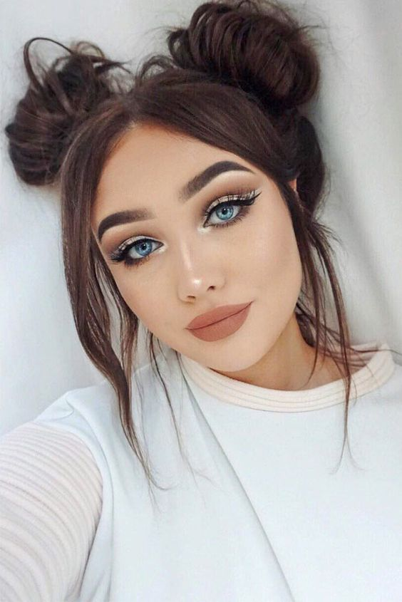 Messy Space Buns With Bangs