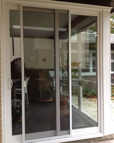 There Is A Sliding Patio Door In Residential Area, Which Is Used Sliding  Insectu2026