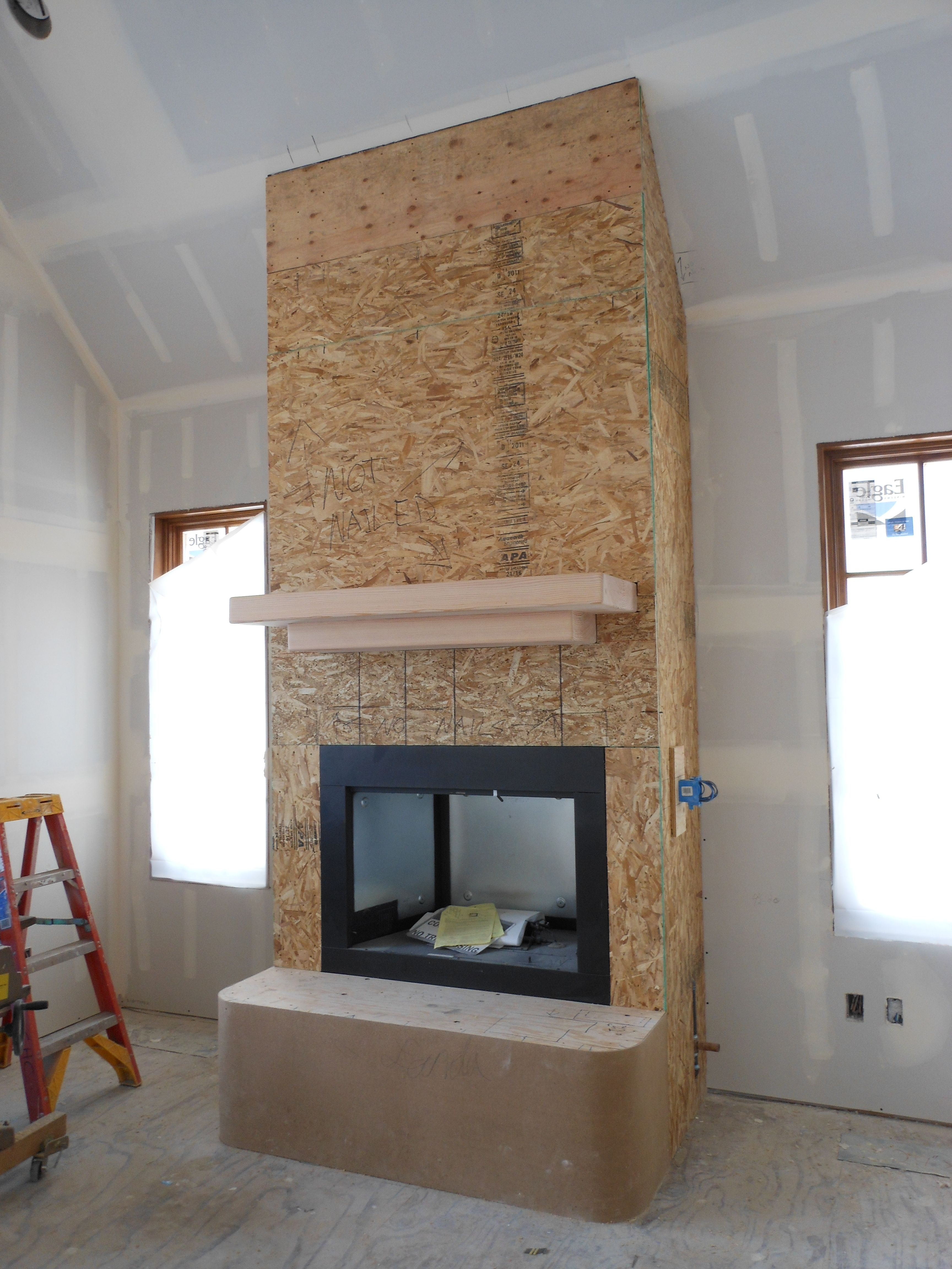 Fireplace Mantle Constructed From Doug Fir Timber Osb Sheathing Is