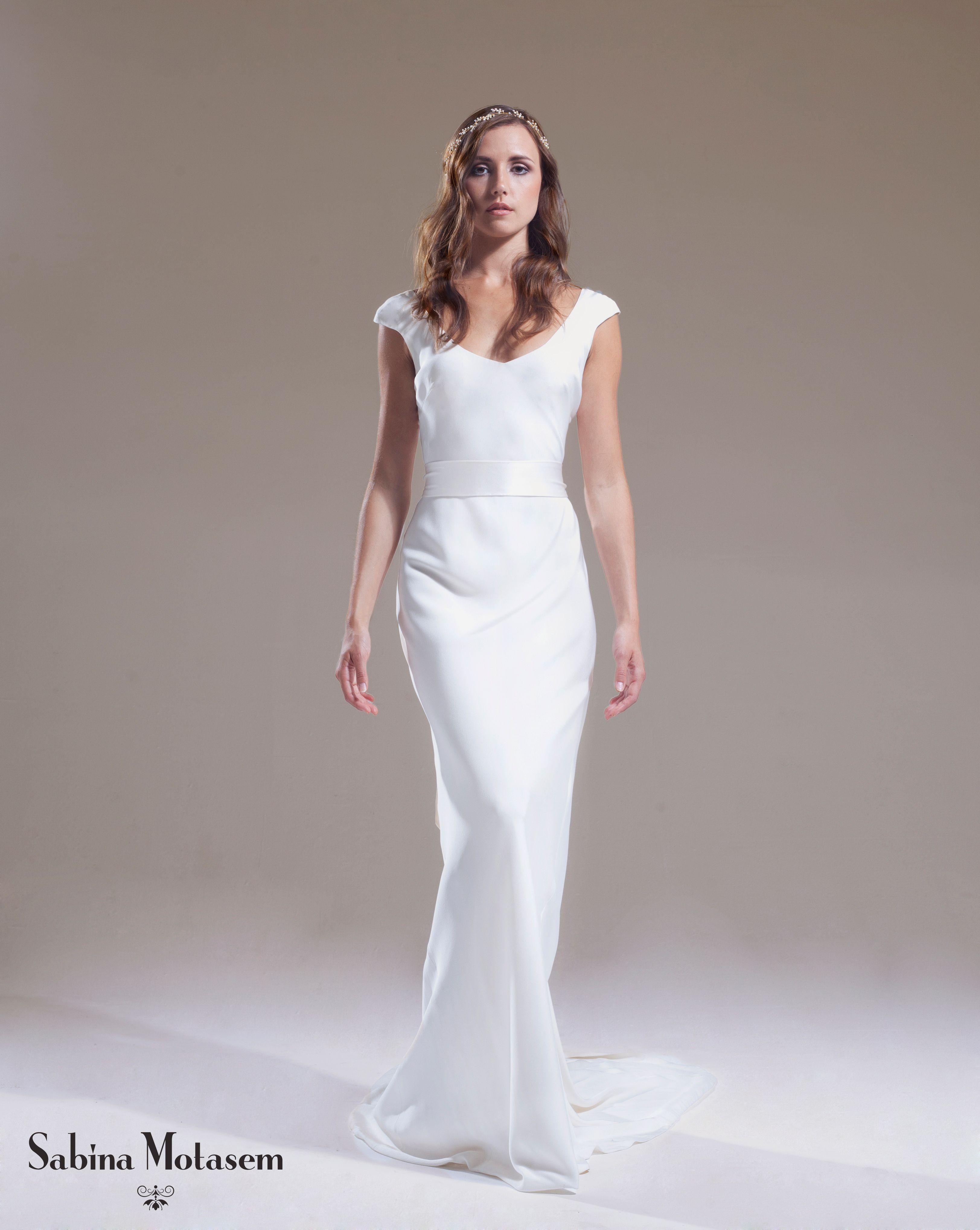 The Lilian dress  – Sabina Motasem. A bias cut, backless, slinky wedding dress with cap sleeves and a puddle train, accessorised with a matching satin sash. www.motasem.co.uk #biascutweddingdress #backlessweddingdress #sabinamotasem