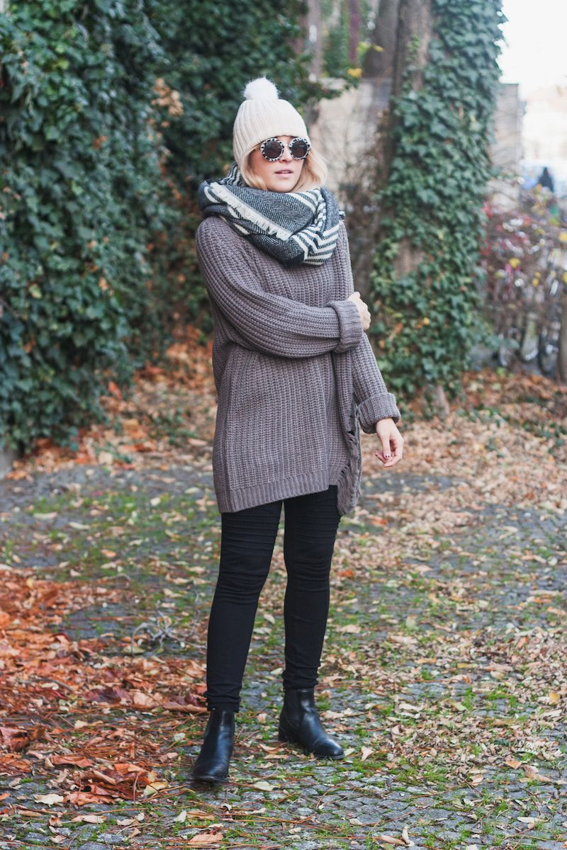 Cold Weather European Travel Essentials & A cozy winter look featuring a blanket scarf, moto leggings and distressed sweater styled by Bryn Newman of Stone Fox Style – How To Wear A Blanket Scarf