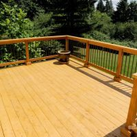 Wood Vs Vinyl For Garden Fencing Cedar Deck Deck Custom Decks