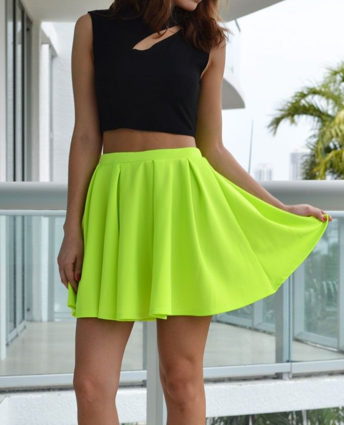 e1f11bd481 Neon+lime+skirt +featuring+a+high+waist+and+pleated+detailing.++Unlined.++Looks+amazing+with+crop+tops!.++Model+is+wearing+size+small.