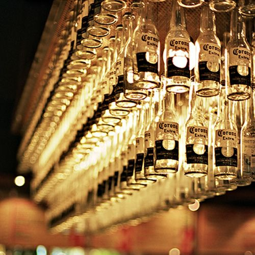 Recycled corona bottle chandelier home styling pinterest recycled corona bottle chandelier mozeypictures Images