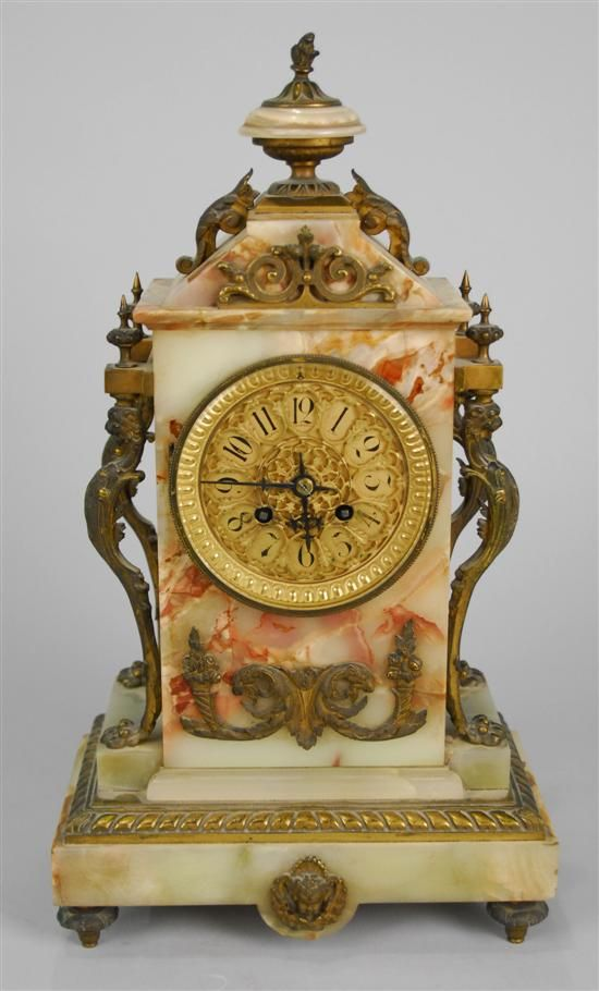 Grogan and Company | FRENCH ONYX AND BRONZE MOUNTED MANTLE CLOCK  decorated with figures of Griffens; height: 17 inches