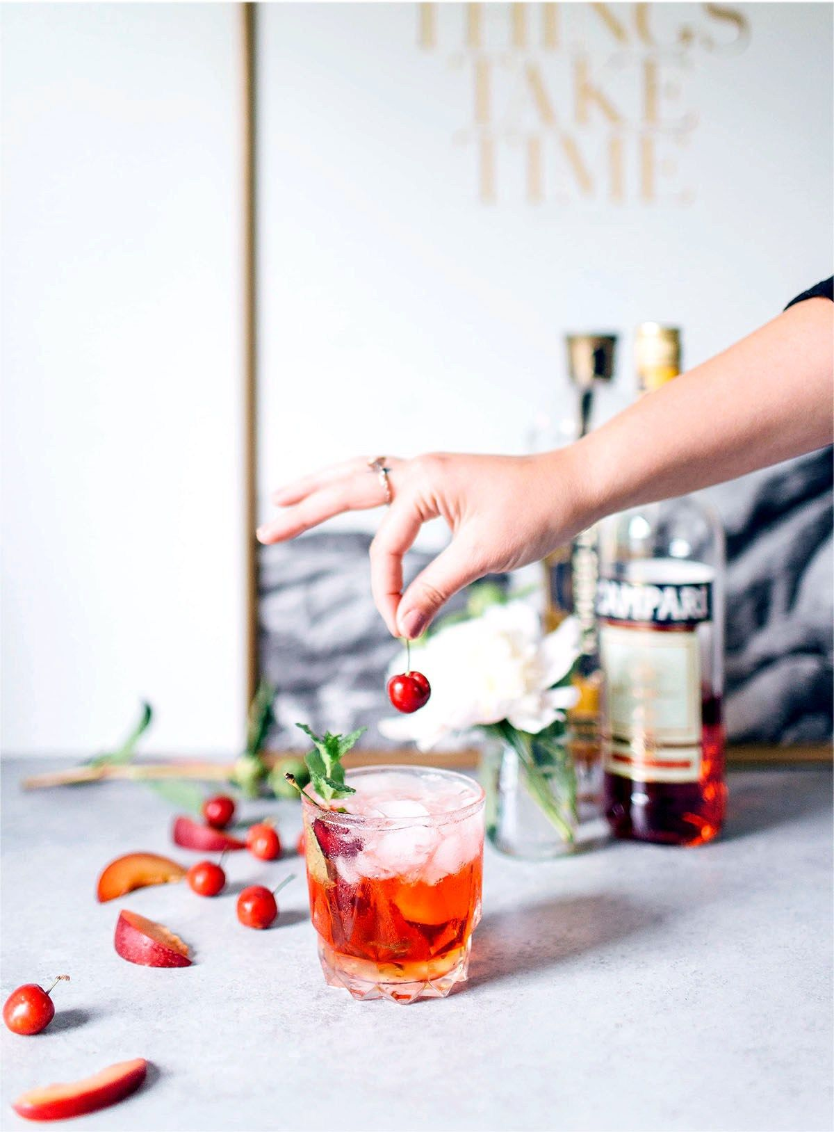 St. Germain Spritzer 1 oz St. Germain Liquor 1 oz Campari 7 oz sparkling white wine (or club soda) Cherries, apricot slices, or mint, for garnish