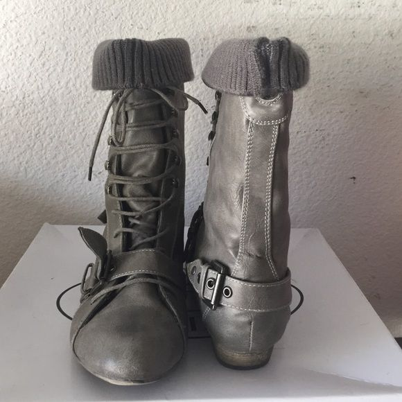 Steve Madden combat boots! Steve Madden Grey lace up combat boots with leg warmers already attached! Comfortable and edgy. Only worn twice. Perfect condition. Only a little stain on the sweater which will come off as shown in the photo above ^. Size 7. They are too big on me but I had to have them! Steve Madden Shoes Combat & Moto Boots