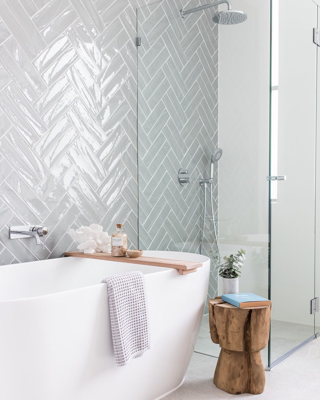 Photo of Beautiful bright and light bathroom with a subtle blue-grey tone tile wall and w…