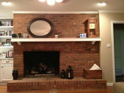 Off Center Fireplace With Brick Work And Mantal