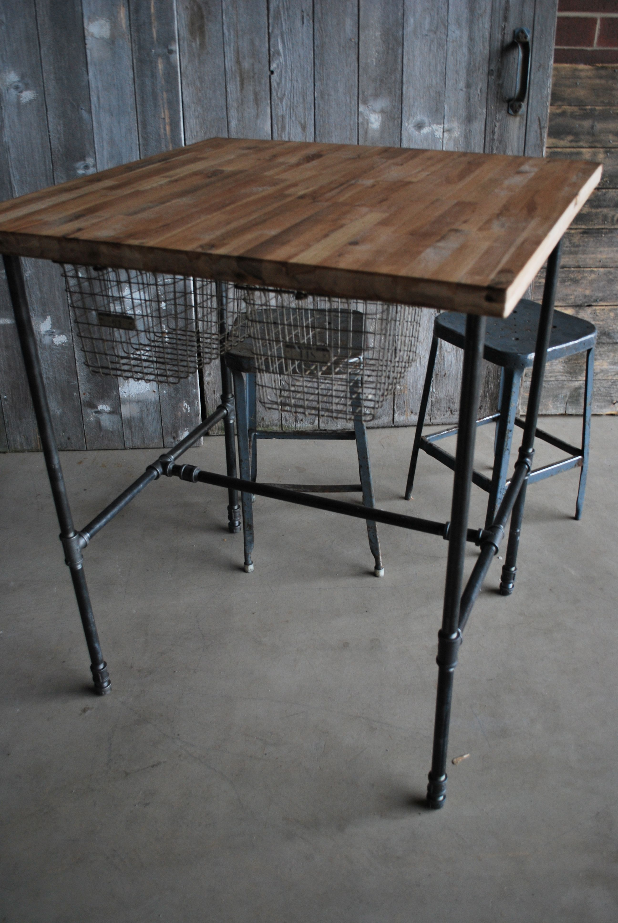 Table made with pipe wood plete with sliding basket drawers