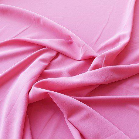 Tela Crepe Rosa Fuerte. Tela de crepe lisa de color rosa fuerte. Crepe opaca, con mucho vuelo y caída, textura rugosa al tacto que recuerda al Crespón y al Koshibo pero de una calidad superior. Tela ideal para la confección de trajes de flamenca, blusas, vestidos y faldas.