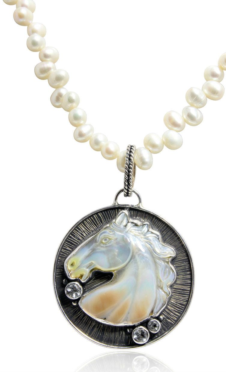 Caracol - Inspired Jewelry and Handbags - Mother of Pearl Horse Head Necklace, $254.00 (http://www.caracolsilver.com/mother-of-pearl-horse-head-necklace/)
