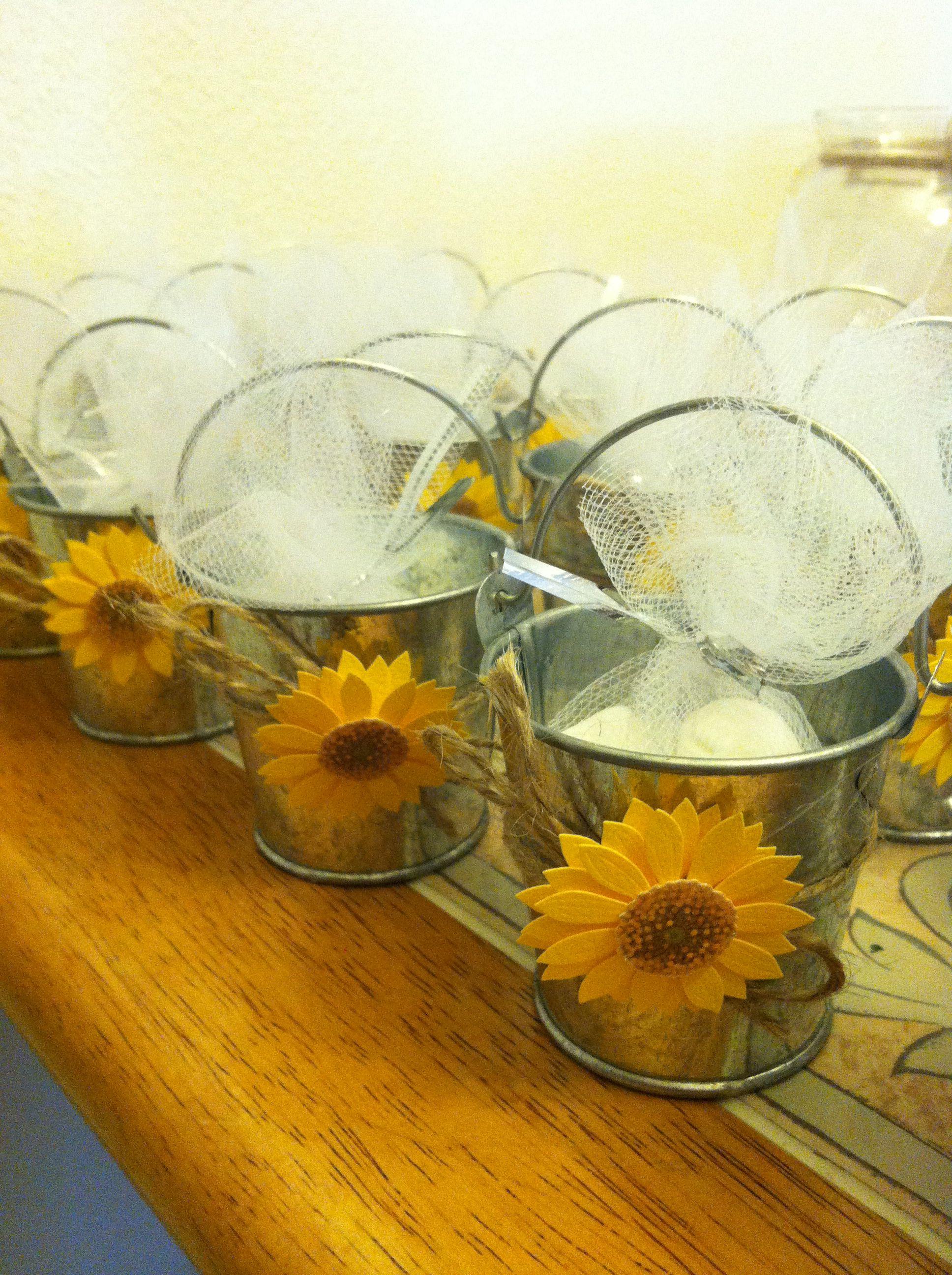 Sunflower wedding favor buckets and flower stickers at