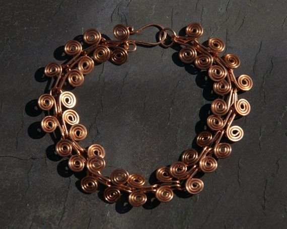 Beautiful copper Egyptian coil bracelet at Etsy listing at https://www.etsy.com/listing/188032188/copper-egyptian-coil-bracelet-with-hook