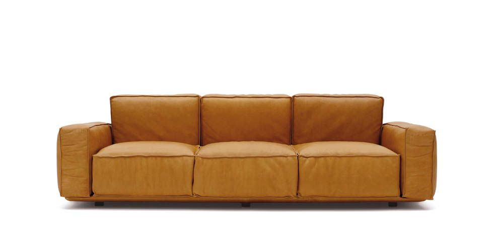 This product, designed in 1976, can be surely considered current, thanks to its extreme formal essentiality. Range is composed of armchair, two or three-seats sofa and pouf, in order to realize never ending compositions, all of them with fully removable cover. Multiplywood base with fibre cover; back, seat and armrest