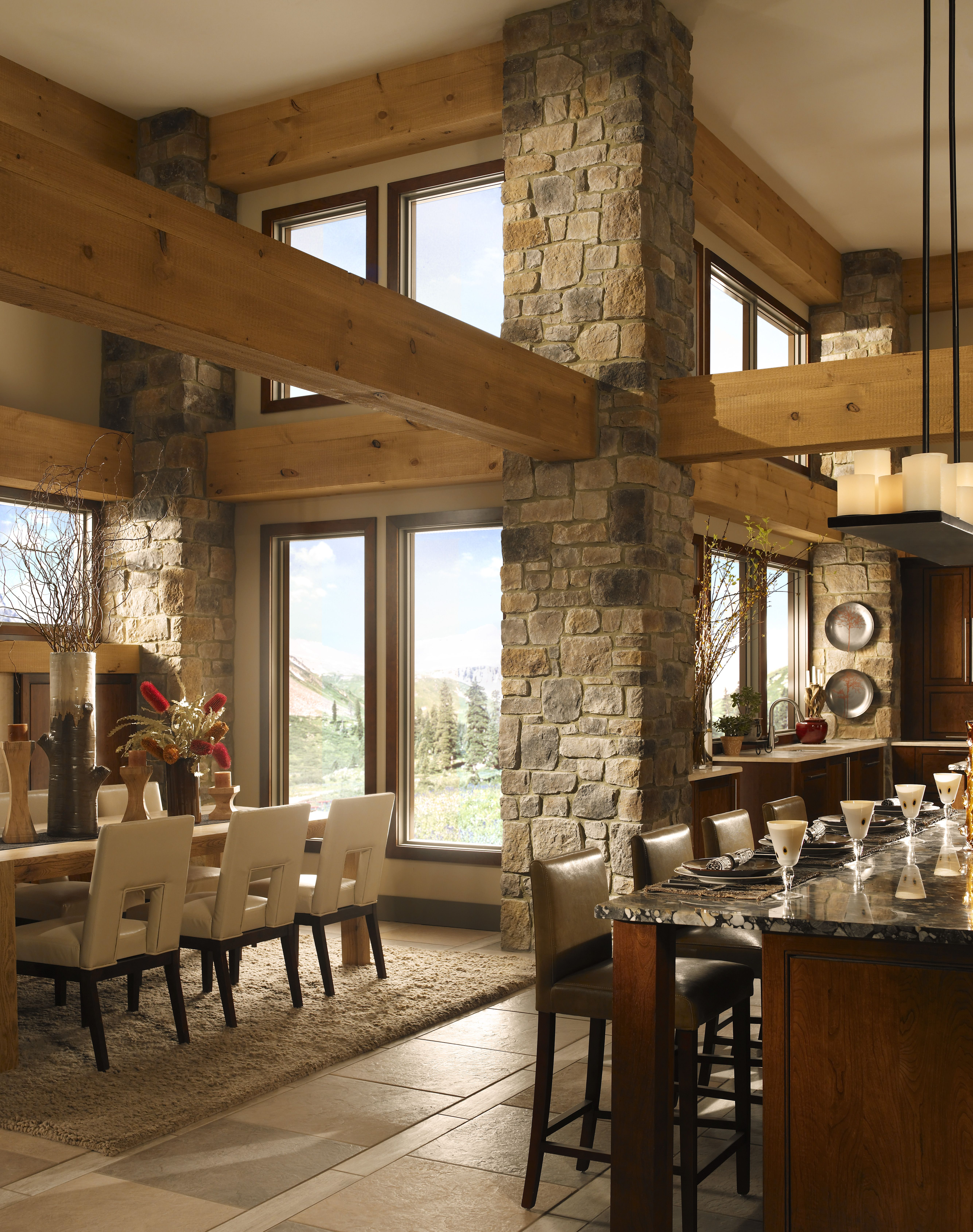 Rustic dining room with stone pillars and wood beams ...
