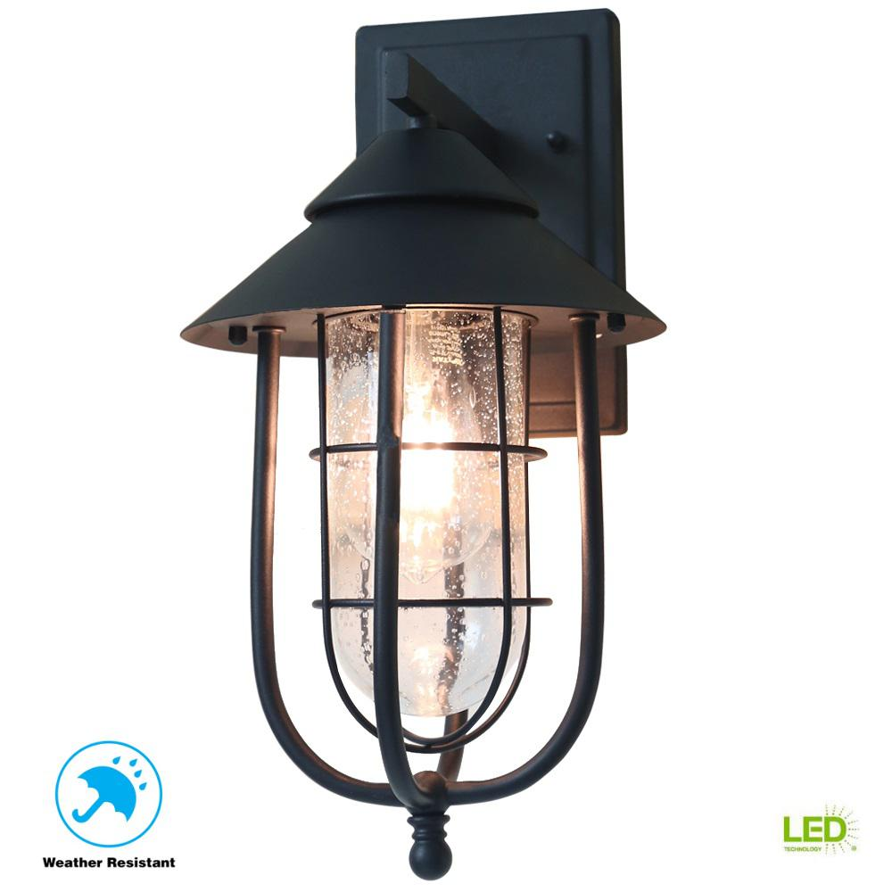 Home Decorators Collection Wisteria Collection 1 Light Sand Black Outdoor Wall Lantern Sconce With Clear Glass Shade 17547 The Home Depot Outdoor Wall Lantern Wall Lantern Outdoor Wall Lighting