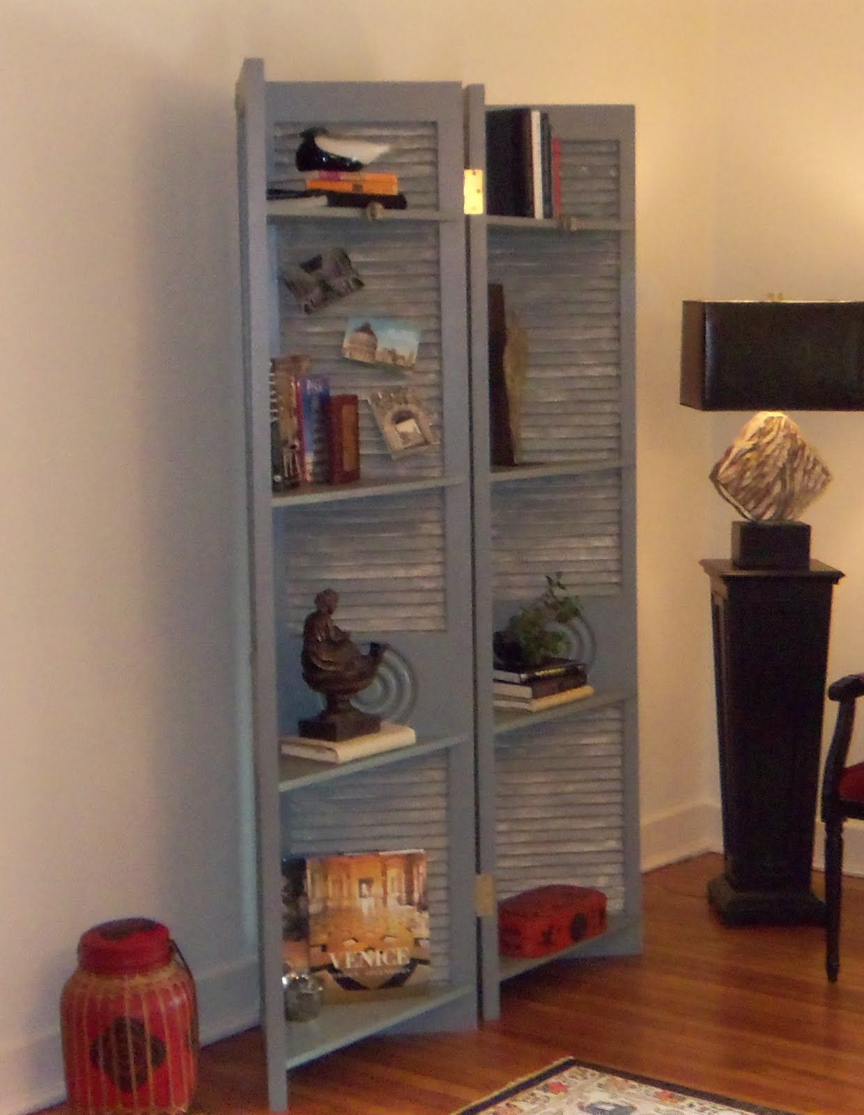 rekaced designs: louvered doors disguised as a screen/shelving