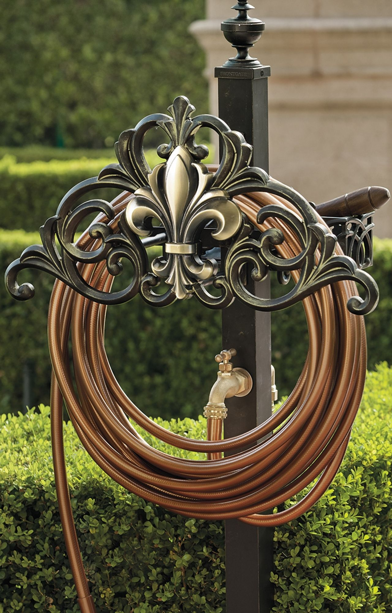 Add A Functional And Decorative Touch To Your Garden With Our Elegant Fleur De Lis Hose Storage