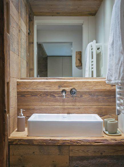 Tanto legno, un po' di ardesia e tocchi di design: una mini-casa in Alta Savoia ci svela il suo 'cuore caldo'