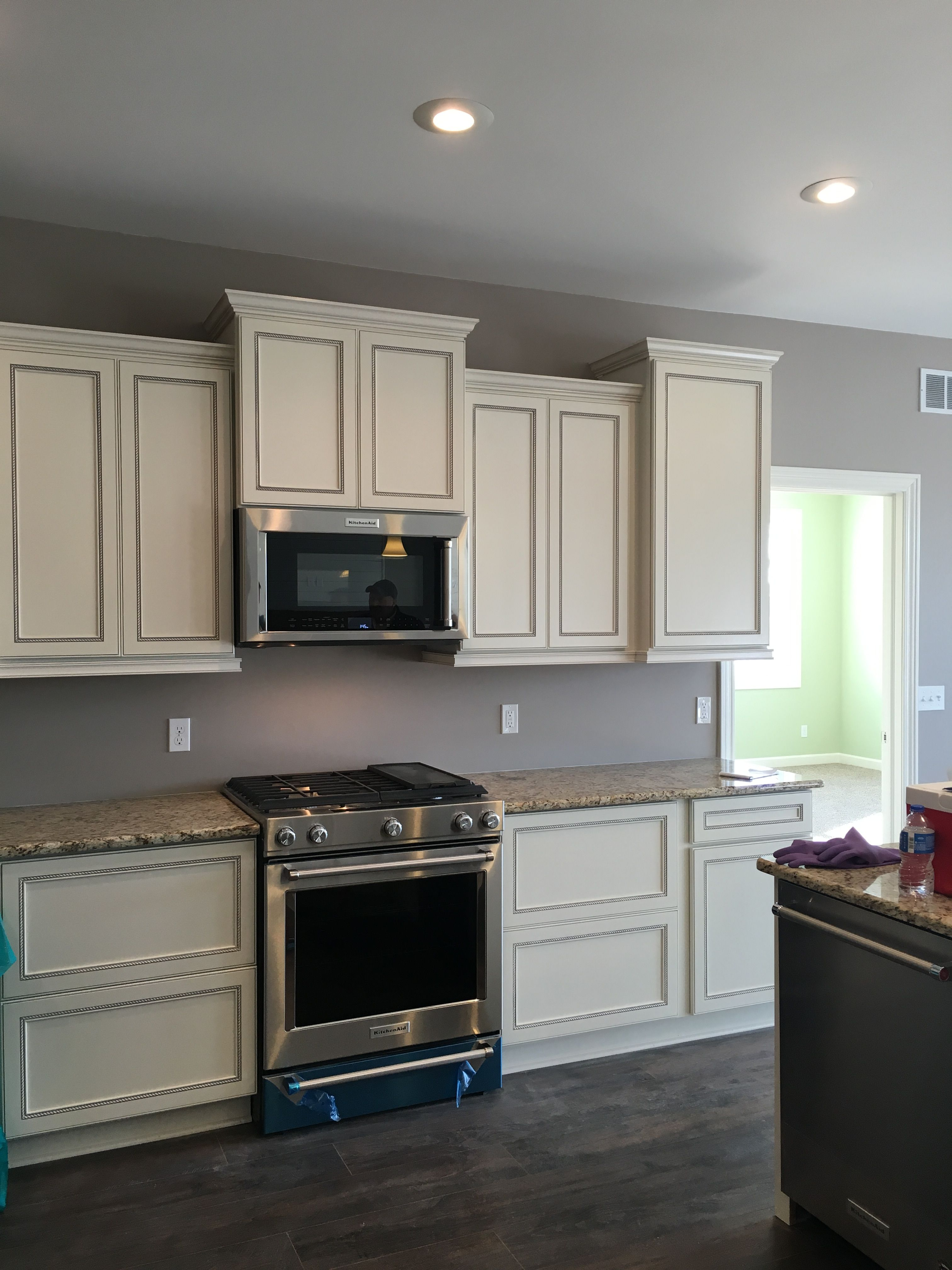 Beautiful tall white staggered cabinets with stainless ...
