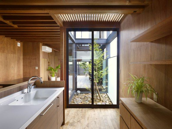 This small family home has an austere appearance but the wood-lined interior is warm and intimate.   www.facebook.com/SmallHouseBliss