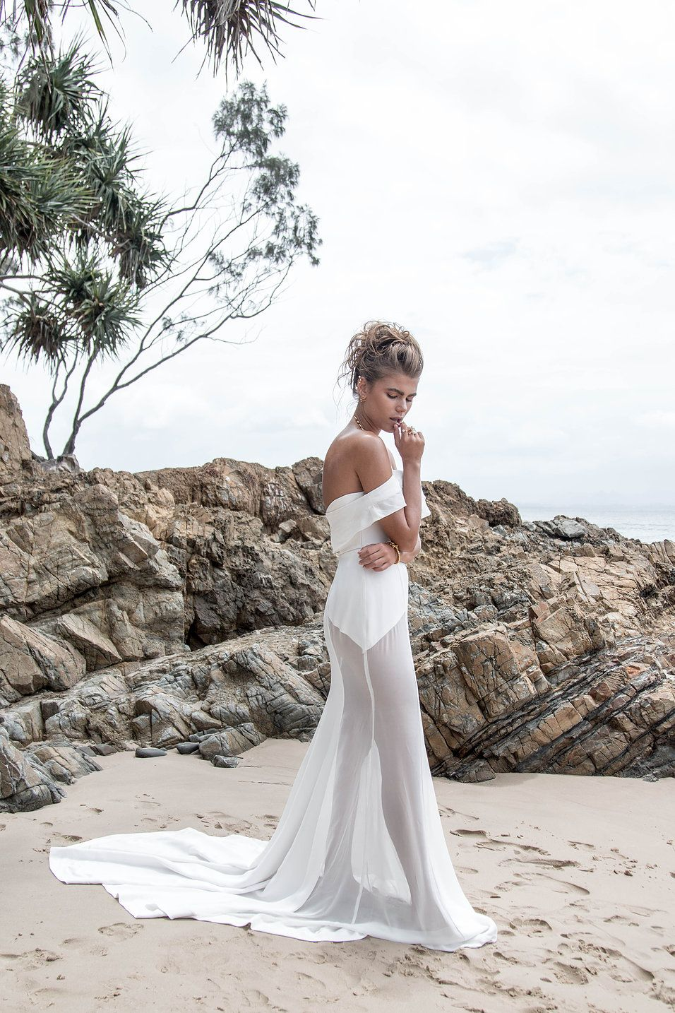 Airy off shoulder wedding gown with sheer skirt perfect for the luxe ...