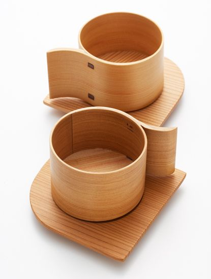 Wappa - a traditional japanese craftwork. they bend thin slices of cedar in round shape and staple the edges by small pieces of cherry bark. because it is made of wood, it keeps moisture in rice in the best balance, as well as keeping food from decay. (these cups designed by Yukio Hashimoto)