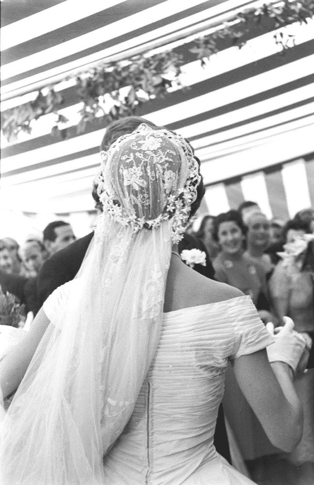 A Back View Of Jacqueline Kennedy S Wedding Veil As She Dances With Her New Husband A Tia Jackie Kennedy Wedding Kennedy Wedding Dress Jfk And Jackie Kennedy