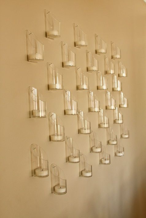 Create a swanky and romantic feel with a wall of candles | InspireDesignandCreate