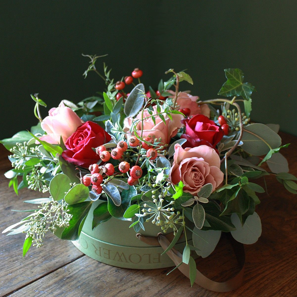 Hat Box Arrangement Filled With Red And Pink Roses, Herbs