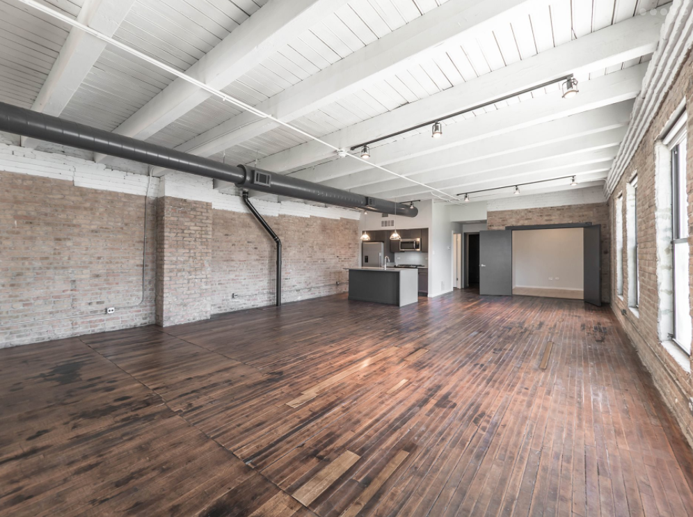 A Chicago Timber Loft Apartment In The West Loop With Dark Wide Plank Flooring White Wood Ceiling Exposed Duct Work And Modern Kitchen Domu