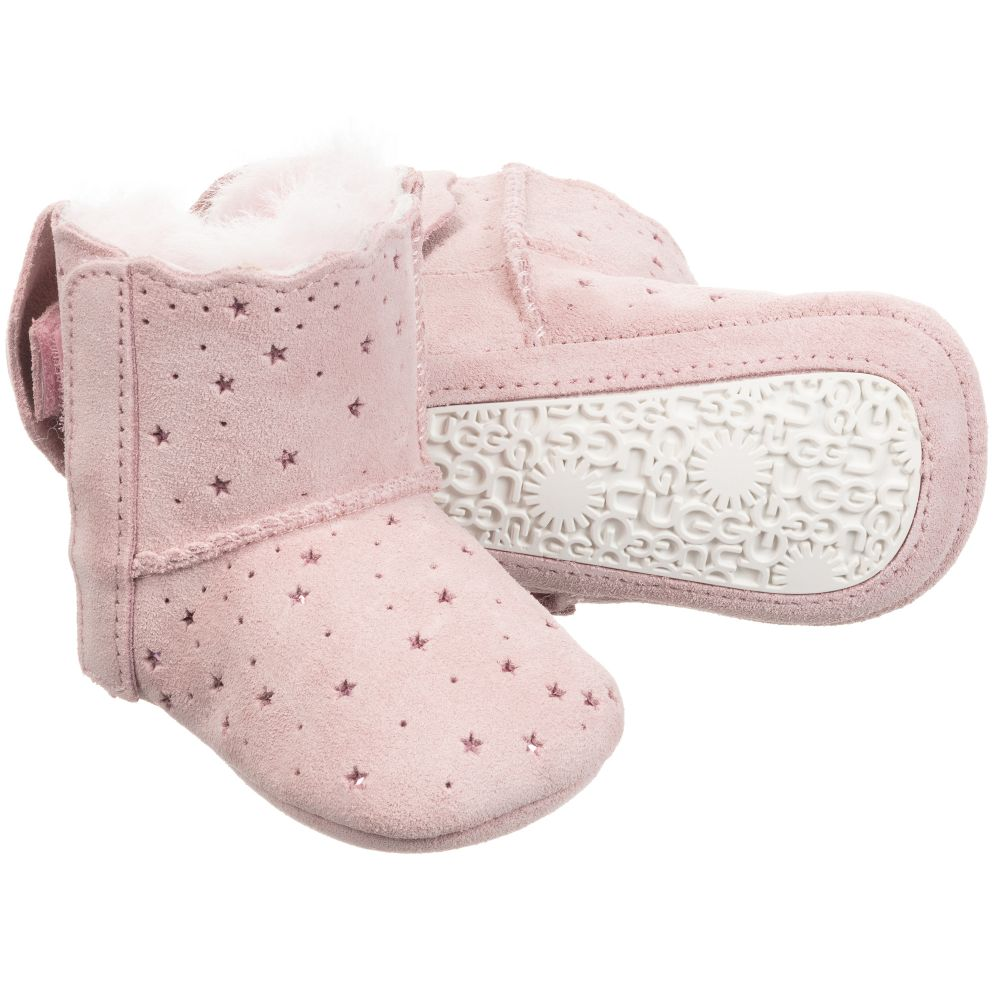 Adorable For Baby Girls A Pink Pair Of First Walker Boots By Ugg Australia With A Metallic Stars Pattern Made F Walker Boots Baby Girl Boots Cute Baby Shoes