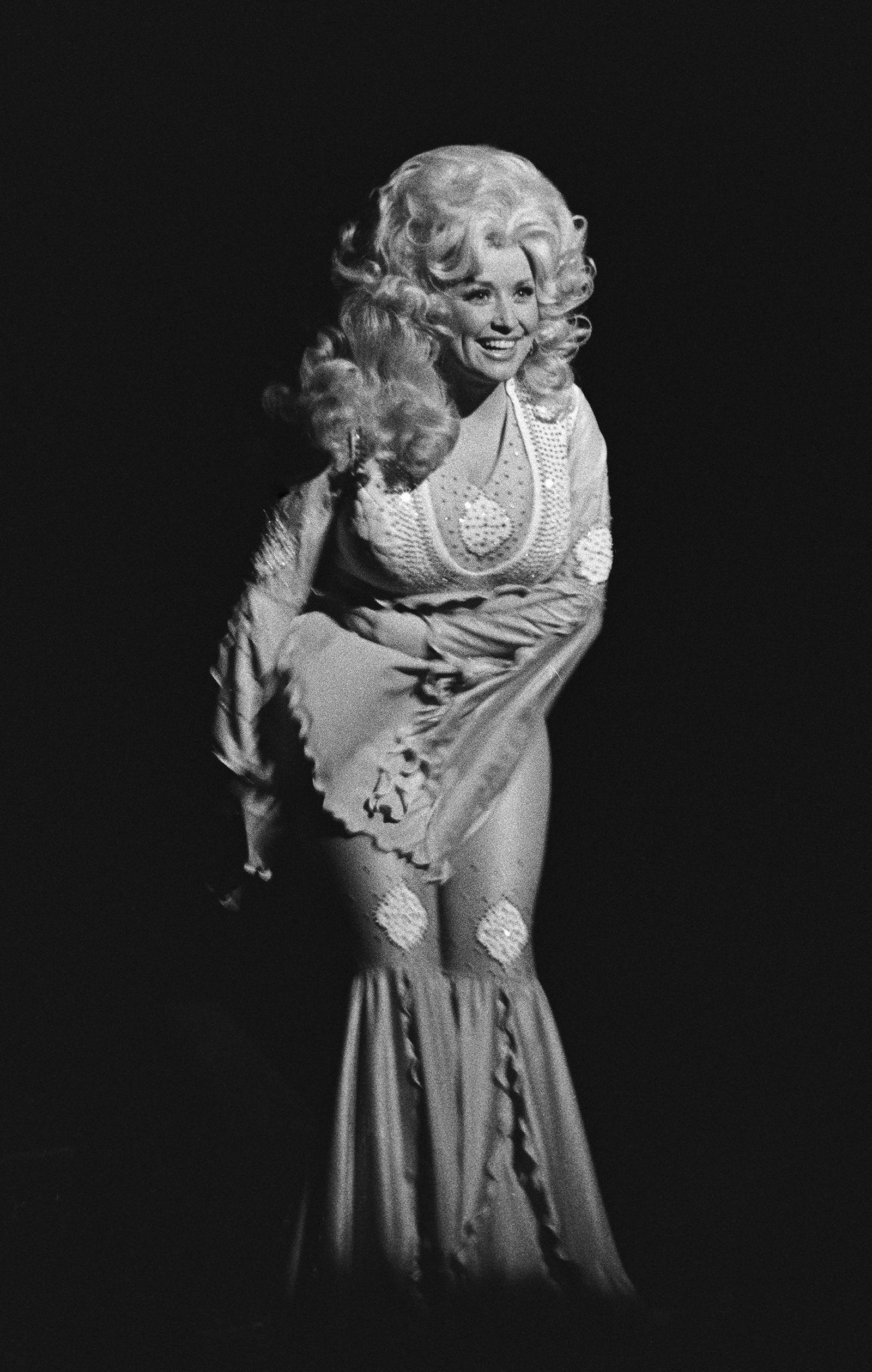 Dolly Parton, 1977- Cosmopolitan.com