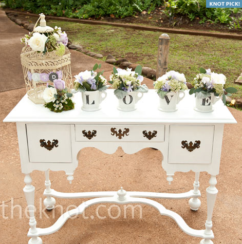 gorgeous vintage table with a birdcage and love the LOVE cups with flowers in them