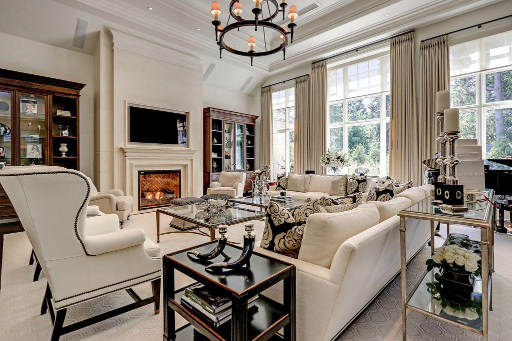 The great room offers 16\u0027 ceilings, floor-to-ceiling windows, black
