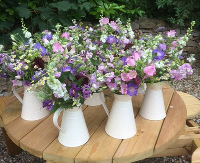Pin By Jess Foster On Wedding Wild Flower Arrangements Church Wedding Flowers Pastel Wedding Flowers