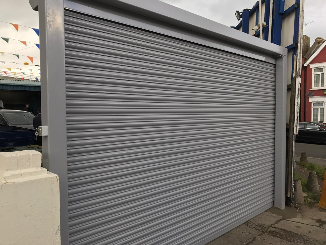 Happy Client With Our Rsg5000 Solid Steel Security Shutter With Goal Post Fitted To His Car Wash Company In Harrow Roller Shutters Shutters Security Shutters