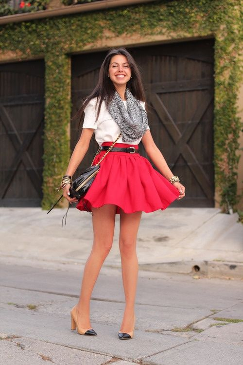 73b90e4e58ef Cute white haf sleeveless blouse with red pleated short skirt and black  leather cute hand bag and black & golden stylish high heels pumps an.