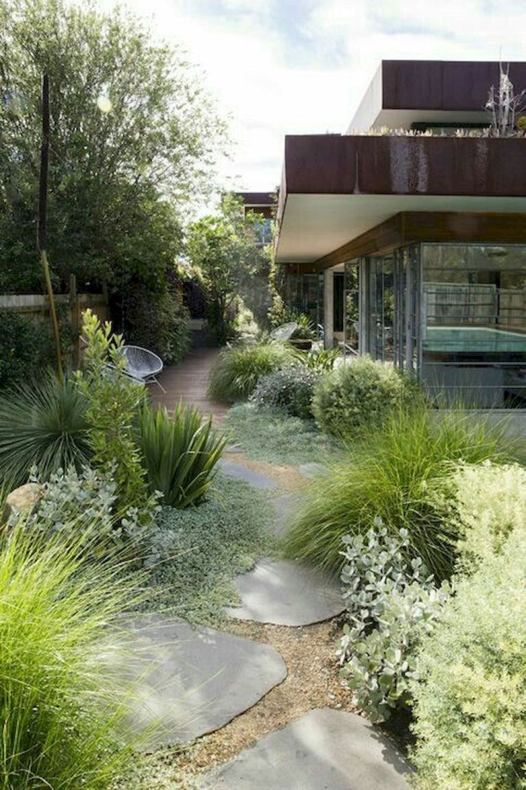Large Flat Stones With Flowy Grasses 07 Incredible Side House Garden Landscaping Ideas With Rocks Hom In 2020 Front Garden Design Modern Garden Backyard Landscaping