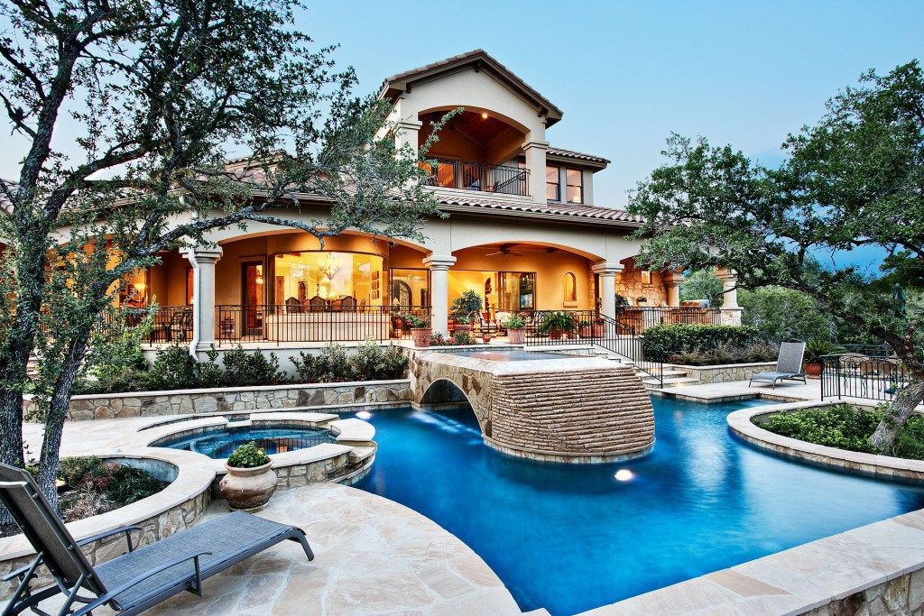 Epic backyard view of sterling custom home pool with stone ...
