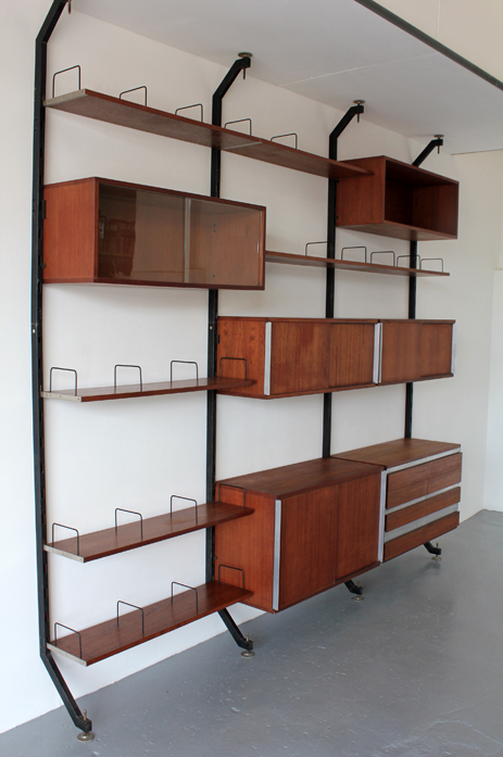 Ico and Luisa Parisi ; Walnut, Aluminum, Enameled Metal and Brass 'Urio' Wall Unit for MIM, 1958.