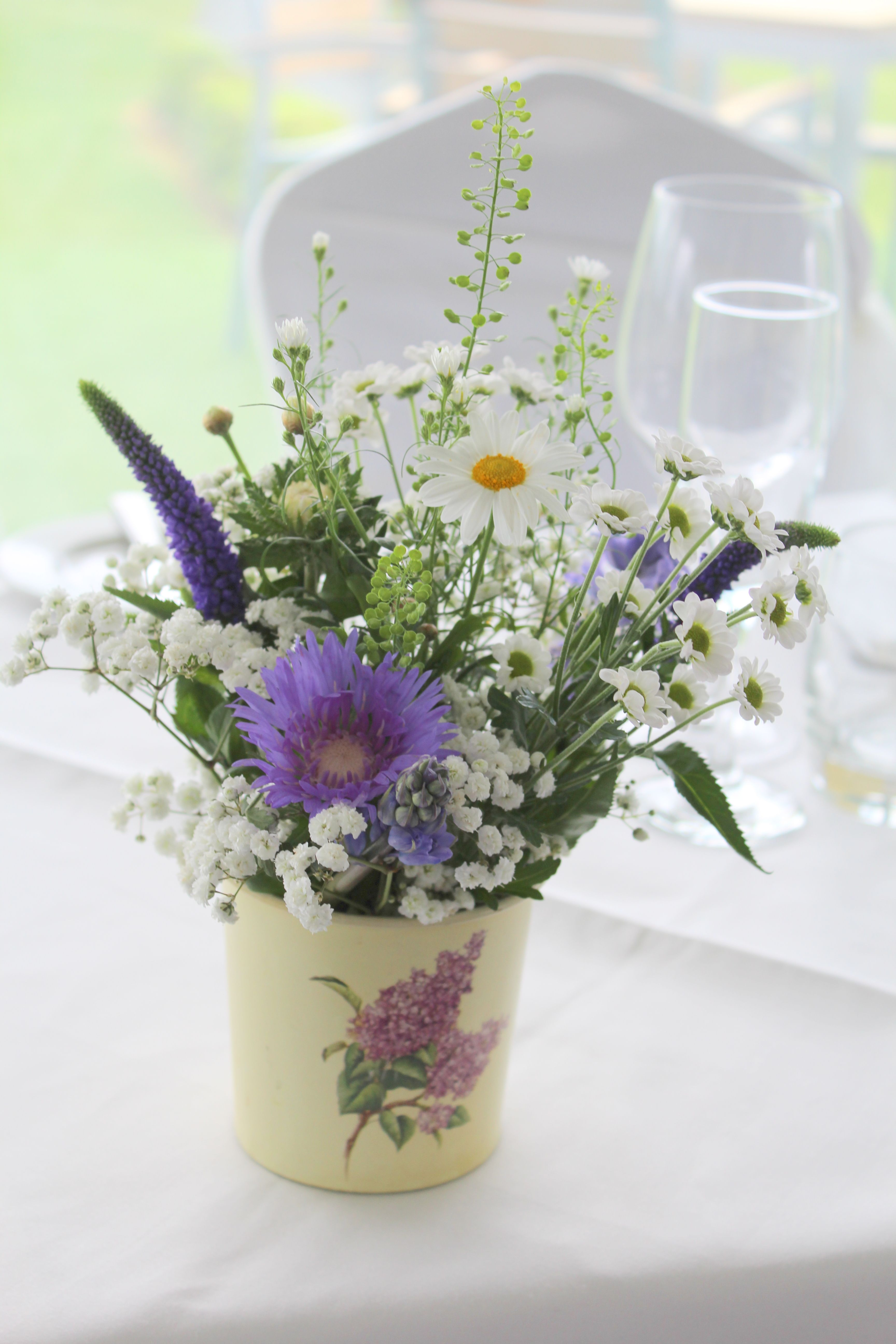 tin bucket filled with country style, rustic flowers in