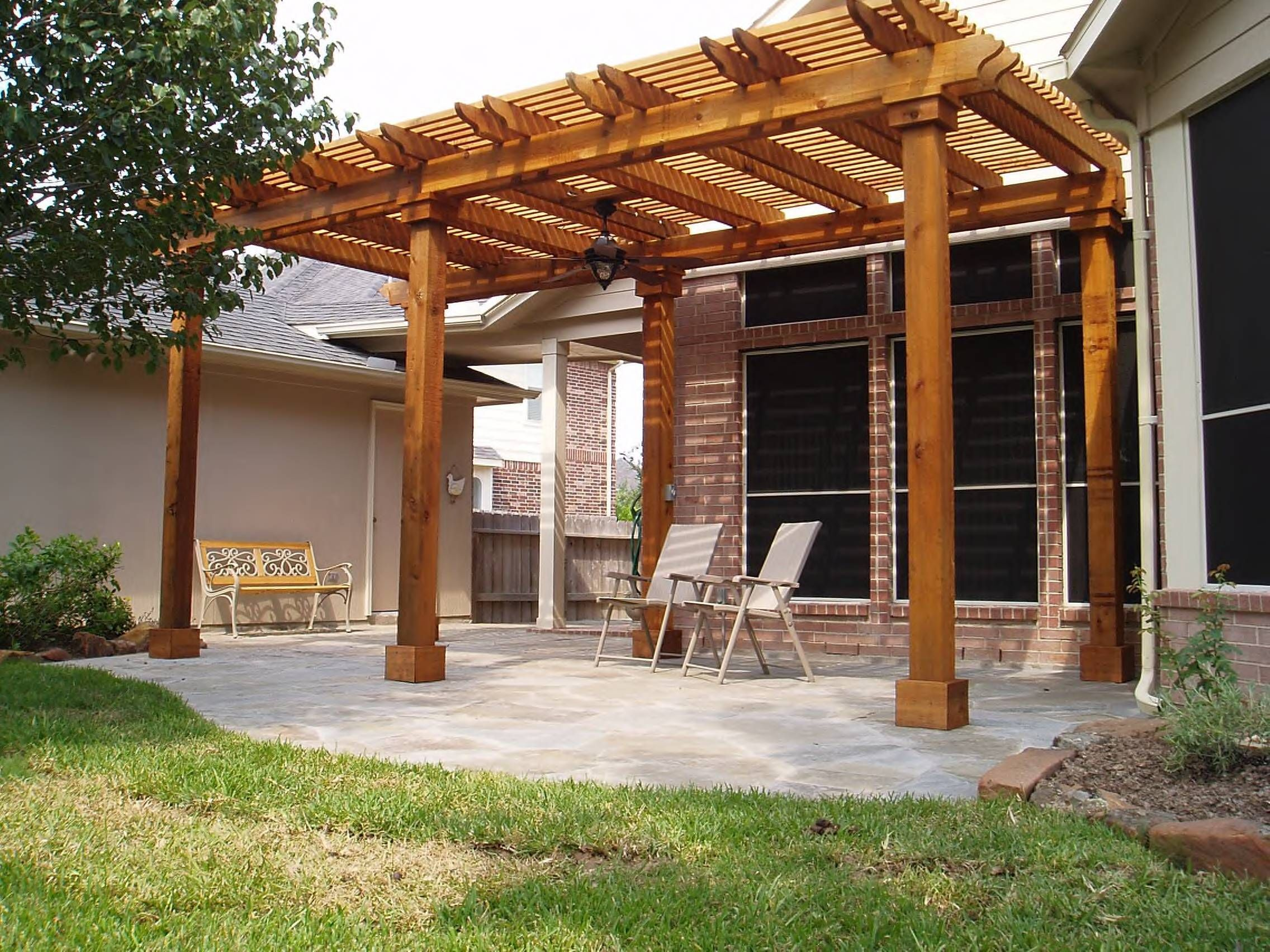 Mahogany pergola deck roof cover with simple furniture in for Garden decking ideas pinterest
