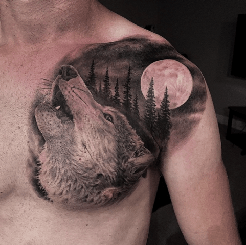 Howl At The Moon Tattoo By Greg Nicholson Inked Inkedmag Tattoo Wolf Art Animal Chest Piece Ink Wolf Tattoos Tattoos Chest Piece Tattoos