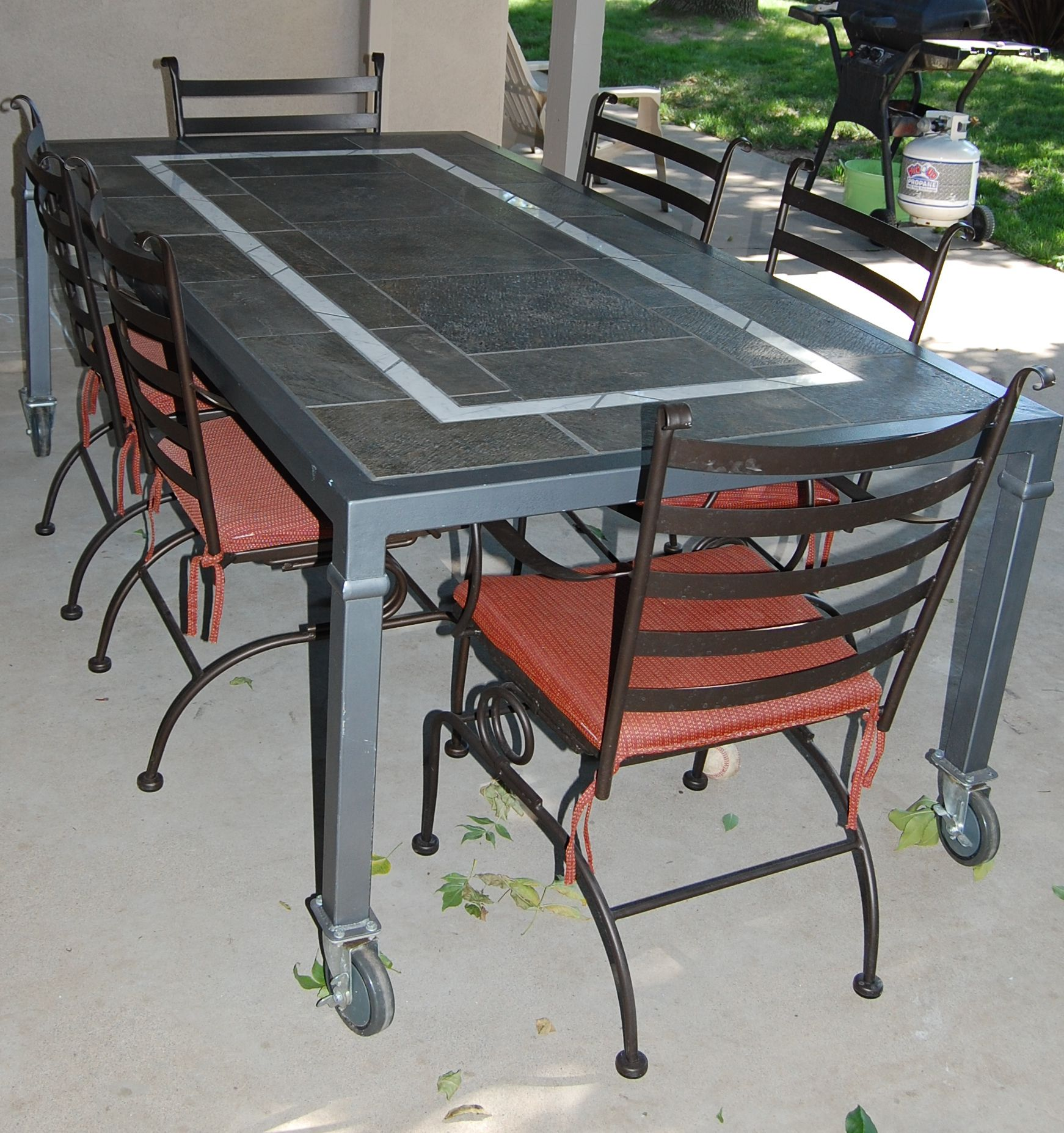This patio table is on caster wheels which makes moving it very easy this patio table is on caster wheels which makes moving it very easy it has watchthetrailerfo