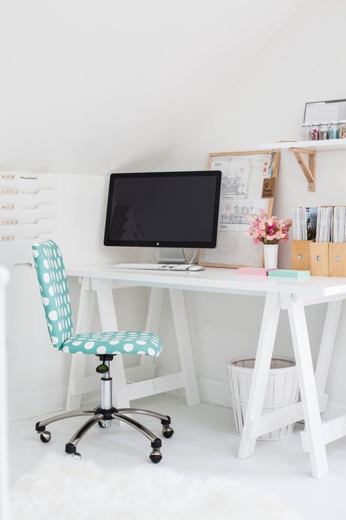 simple white and cute workspace with blue and pink accents.