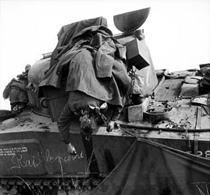 SSM William Parkes of British No. 3 Squadron, 2nd (Armoured) Irish Guards dead on his M4 Sherman tank, near Eindhoven, the Netherlands, 17 Sep 1944.