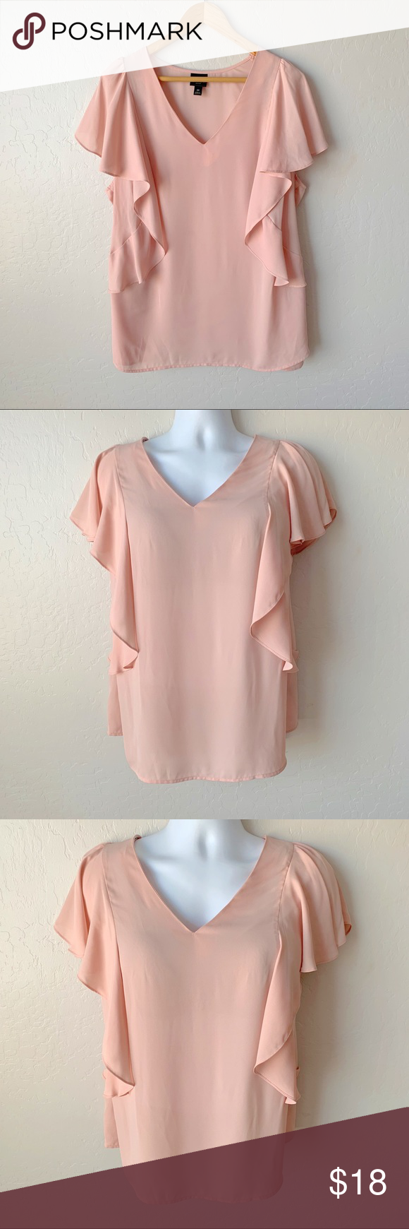 "Blush Pink Ruffle Sleeve Top - Size 2X Blush Pink Flutter Sleeve Top - Size 2X. Feminine v-neck blouse with trendy flutter sleeves. Pair with a skirt or slacks for the office, or go dressy casual with your skinny jeans and ankle boots. So versatile! Smoke free home.  ▪️Armpit to armpit: 25"" ▪️Shoulder to hem: 29"" ▪️100% polyester  ▪️Machine washable Worthington Tops Blouses #skinnyjeansandankleboots Blush Pink Ruffle Sleeve Top - Size 2X Blush Pink Flutter Sleeve Top - Size 2 #skinnyjeansandankleboots"