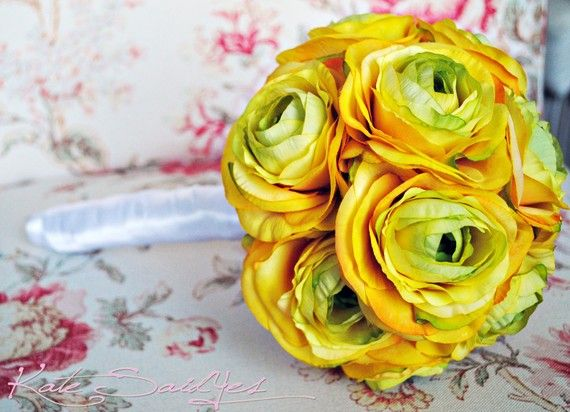 I believe I have abandoned the sunflower and fallen in love with the ranunculus. It certainly wasn't the name that got me though. Yellow Ranunculus Silk Wedding Bouquet by KateSaidYes on Etsy, $70.00
